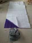 Insulation has been cut and sewn to match the size of the purple nylon.